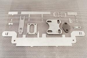 Darstellung verschiedener Laserzuschnitte aus Metall